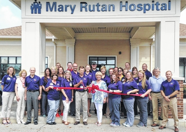 The Champaign County Chamber hosted a ribbon-cutting for the Grand Re-opening of Mary Rutan Hospital Urbana Clinic at the new location, 1880 E. U.S. 36 in front of Walmart, on Aug. 19. Attending were, front from left, Sarah Leichty, Cheryl Varian, Dr. Grant Varian, Sara Evans, Theresa VanderRoest, Andrea Young, Tom Denbow, Sandi Arnold, Kelsey Britenstine, Johnna Cassell, Regan Middleton, Gary Schenkel, Chad Ross, back row, administration, employees and community supporters. For info on past or future ribbon-cuttings, call the Chamber at 937-653-5764.