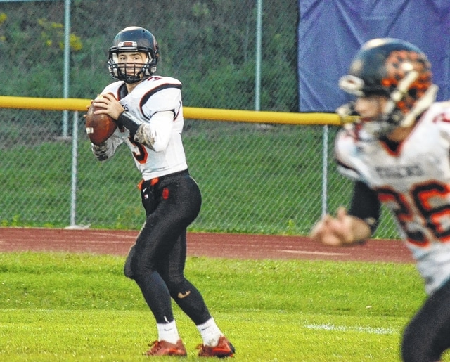 West Liberty-Salem quarterback Luke Woods looks to pass against Mechanicsburg last week. The Tigers have struggled in the passing game so far this season.