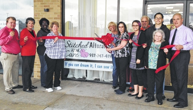 The Champaign County Chamber hosted a ribbon-cutting for the grand opening of Stitched with Care Alterations & Dry Cleaning Services, located in Suite 9A near Kroger, 1637 E. U.S. Route 36 in Urbana. The business specializes in bridal gowns and special-occasion dress alterations, along with 30-minute pant hems, mending, zipper replacements, etc. From left are Matt Sehnert, Carla Brown, Champaign Economic Partnership Representative Tiffany Couts, Pam Moore, Chamber Director Sandi Arnold, owner Catherine Loeloff, Carrie Leese, Bob Loeloff, Eric Leese, Linda Hancock, city Director of Administration Kerry Brugger. For more information on services available, call Stitched with Care: 937-747-4198. For information on past or future ribbon-cuttings, call the Chamber at 937-653-5764.
