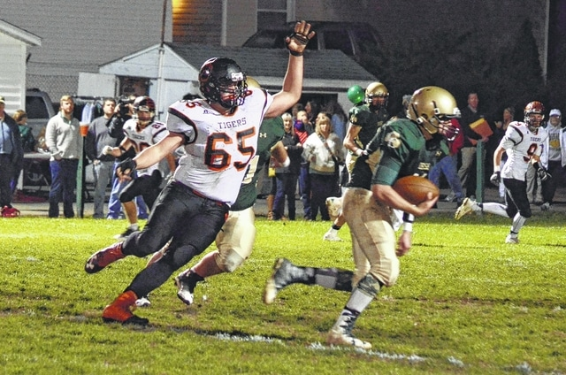 West Liberty-Salem's Trevor Burden (65) terrorized the Irish offense all night, including an interception return for a touchdown on the first play from scrimmage.