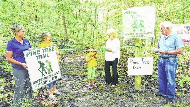 The Champaign County Chamber & Covenant Lutheran Church on Sept. 11 celebrated the Pine Tree Trail Head project of the St. Paris church with a ribbon-cutting, outdoor service and potluck. The church's third year of community outreach with God's Work, Our Hands Ministry cleared the Pine Tree Trail at Kiser Lake State Park and built a boardwalk through a marshy area. From left are Hiedie Gibson, Brenda Cook, Amaya Close-Barger, Chamber Director Sandi Arnold and Pastor Stephan Becker. For past or future ribbon-cuttings call the Chamber at 937-653-5764.