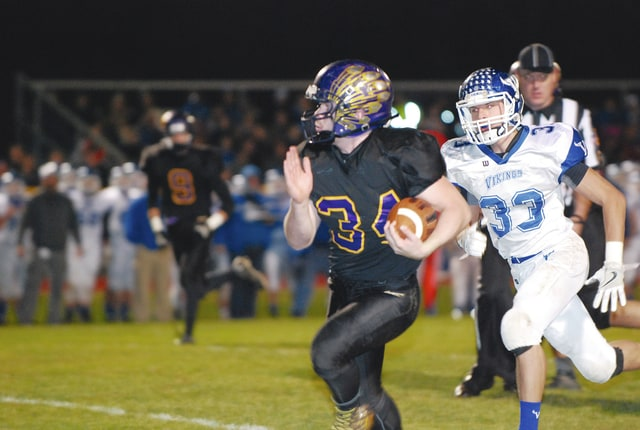 Mechanicsburg running back Dustin Knapp (34) breaks free during last Friday night's win over Miami East in the opening round of the Division VI, Region 24 football playoffs. The Indians (11-0) play Delphos Jefferson (10-1) Friday night at Bellefontaine.