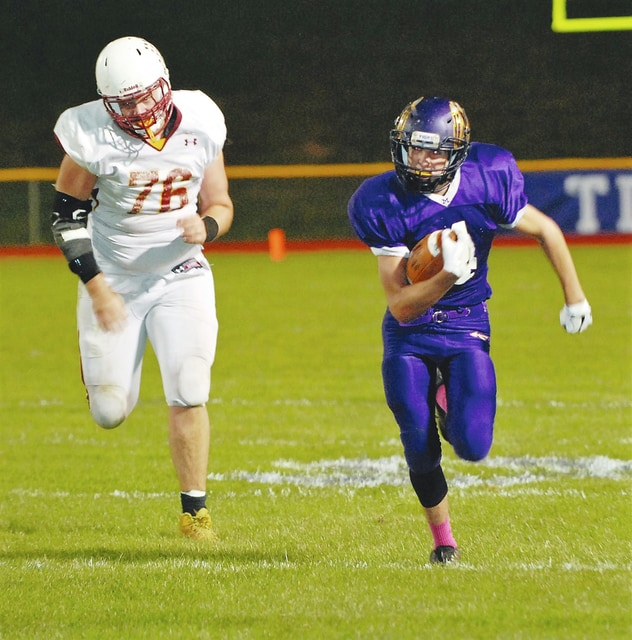 Mechanicsburg's Alex Rhine out-runs the Northeastern defense during a recent game.