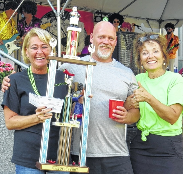 The $1,000 first place winners of the Chili Cook-off are, from left, Melissa Brumbaugh, Nate Dawson and Tara Harper, whose team name was Fire Flye Chili. They won with a total score of 191 points.