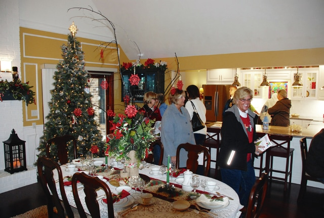 Visitors tour the main living area of the Boutell home at 369 Camelot Drive in Urbana.