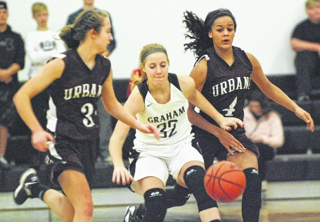 Graham's Kayla Tullis battles for possession with Urbana's Hunter Rogan (4) and Cassidy James during Wednesday night's game at GHS.