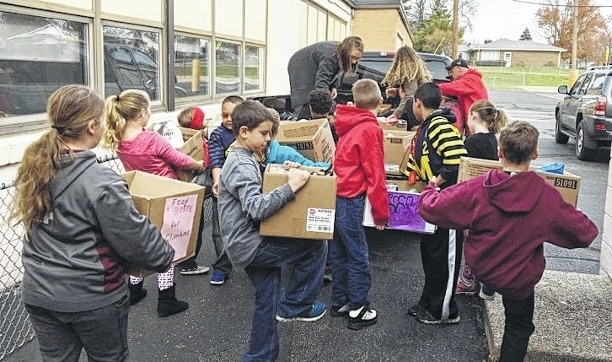 The East Elementary Kindness and Compassion (KC) Club sponsored a successful food drive. East Elementary donated 888 food items to the Caring Kitchen. The club also sponsored a card-making event during lunches for about one week. East Elementary students made 352 cards to send to military who will be stationed out of the country over the holidays.