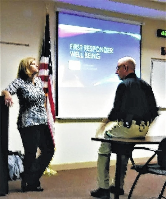 Dr. Jacqueline Allen discusses points of her presentation with Officer Mike McRill. Her mental health presentation concerning issues such as depression, anxiety and PTSD was offered to first responders in the area.