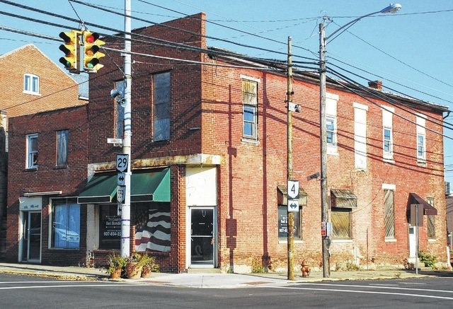 """Vacant structures such as these two in the heart of downtown Mechanicsburg are what village officials hope to avoid in the future with pending legislation referred to as the """"demolition by neglect"""" ordinance. Located at 2 and 4 N. Main St., both properties were ordered by the Champaign County Board of Revision in December 2016 to be sold in the coming months by the sheriff."""