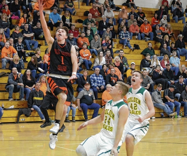 West Liberty-Salem's Neil Markin (1) glides in for a layup in transition on Tuesday at Madison Plains. It was the Tigers' first game since a school shooting left two students injured on Friday.