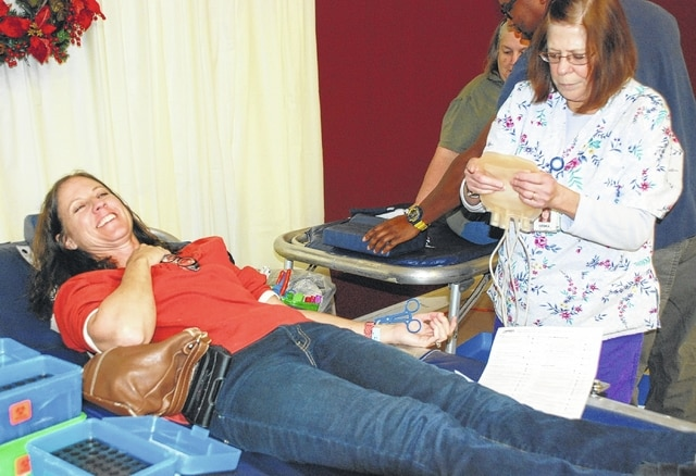 Paige Thompson, left, prepares to donate during the Community Blood Center's blood drive at the Church of Christ in Christian Union Fellowship Hall on Monday. Attending to Thompson is phlebotomist Debbie Williams. For more information about blood drives in the local area, log on to www.givingblood.org.