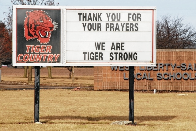 The sign in front of West Liberty-Salem Local Schools on U.S. Route 68 is shown from Sunday morning. There will be no classes at the school Monday but classes will resume on a one-hour delay Tuesday.