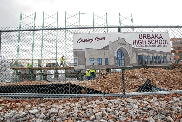 Construction crews are shown at the new Urbana High School site on Monday. Weather has been cooperative for the extensive building project. The new high school, being built on the site of the current high school, is predicted to be open to students by March 2018, and be officially completed by summer 2019.