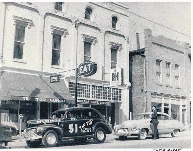 Then: This circa 1950 photo shows two businesses of Miami Street's past: Tip Top restaurant and Urbana Implement Co.
