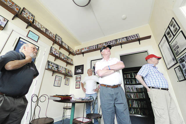 Anthony Weber | Troy Daily News Miami Valley Veterans Museum Curator Terry Purke conducts a tour of the Miami Valley Veterans Museum recently in Troy following the unveiling of the Veterans Marching Through Time 1775-2016 mural.