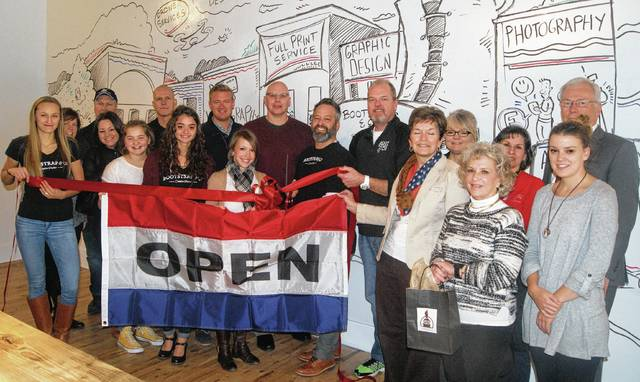 The Champaign County Chamber of Commerce hosted a ribbon-cutting at the new office of Bootstrap & Co. Creative Studios at 112 S. Main St. in Urbana on March 9. From left are Katelyn Martin, Angela Detrick, Ron Quesenberry, Sarah Mitchell, Liberty Bloemhard, Ken Kowalski, Ciska Bloemhard, Jamon Sellman, Chamber Director Lydia Hess, Paul Waldsmith, owner Mark Bloemhard, Michael Forr, Marcia Bailey, Tami Purinton, Vicki Deere-Bunnell, Jenny White, Sarah Thornton and Bill Heitman.