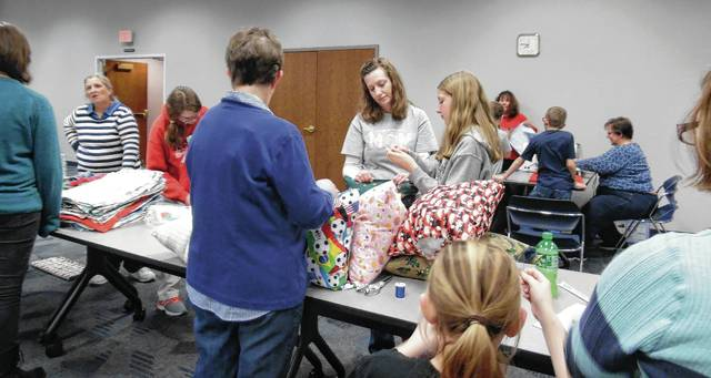 Champaign County 4-Hers and friends construct pillows for hospitalized children.