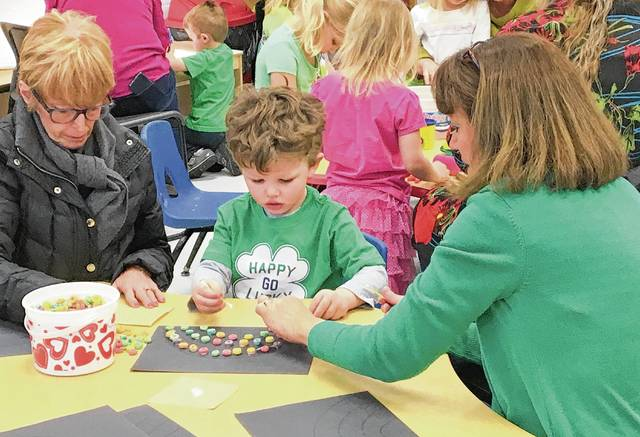 Mollie Fox, Braedy Fox and Denise Saintignon are pictured during Grandparents Day at the YMCA.