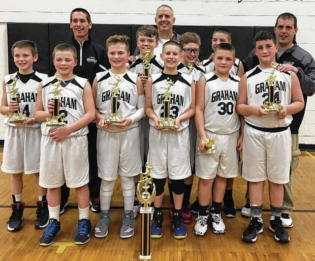 The Graham 6th Grade Boys Basketball team finished the season with a 24-4 record winning both the Regular Season and Tournament Championships for the Dayton Metro D2 Conference. Pictured are Bode McGuire, Eli Hollingsworth, Nathan Ryman, Sam Ludlow, Nick Prince, Ian Back, Tristan Maxwell, Josh Still, Ben Sells. Coaches in back: Marc McGuire, Steve Prince, And Tony Sells.