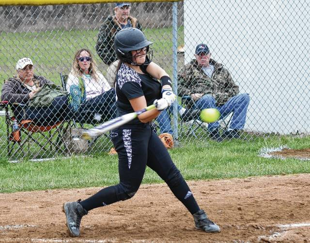 Graham's Madison Bryant (pictured) smashes a pitch against Mechanicsburg on Monday. Bryant hit a home run early in the contest to put the Falcons on top.