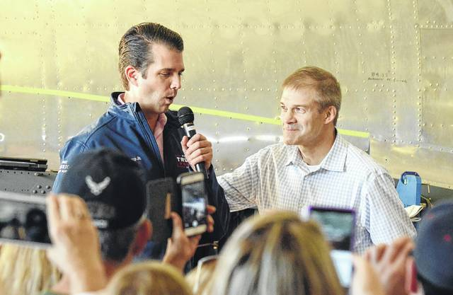 Congressman Jim Jordan (R-Urbana) welcomes Donald Trump Jr. to Champaign County Aviation Museum on Nov. 5, just days before the Nov. 8, 2016 election. Trump Jr. and Jordan were on a campaign swing through Ohio on that Sunday in what turned out to be a successful effort to win Ohio for President Donald J. Trump. In a county where the majority of voters supported both Trump and Jordan, the divide between the two isn't deterring locals from supporting their locally born and raised congressman.