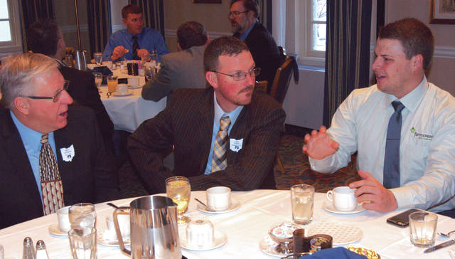 Gary Brock photo Champaign County farmer Josh Yoder, at center, talks with other Ohio farmers including Greg Garman, at left, of Ross County on March 15 at the Capital Hill Club in Washington D.C. before hearing from a number of speakers, including House Speaker Raul Ryan. The trip was sponsored by the Ohio Farm Bureau. Pictured at right is Union County Farm Bureau President Ron Burns.