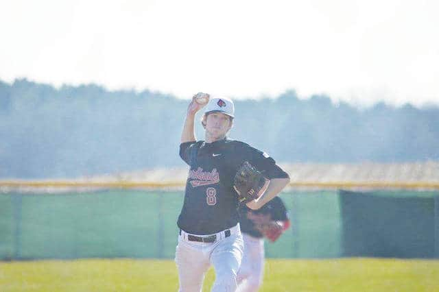 Triad's Shane Ford (pictured) delivers to the plate during Wednesday's game at Triad.