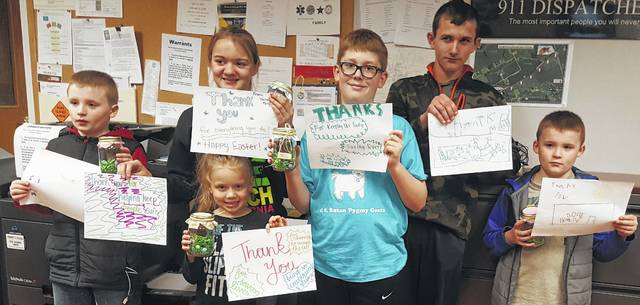 On April 8, six For the Love of Everything 4-H Club members delivered posters and gifts to the Champaign County 911 Communications Center. The posters and gifts were made by the club's 18 members to thank them for their hard work keeping Champaign County residents safe. The week was Emergency Dispatcher Appreciation Week. Shown are club members, front, Maddie Wright, back row, Connor Massie, Josie Nunamaker, Carter Titus, Joey Nunamaker and Toby Massie.