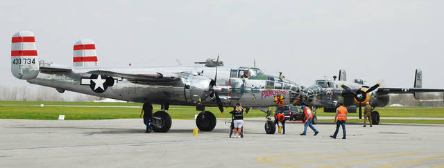 Historic-era airplanes gather on the tarmac at Grimes Field for the weekend's gathering of B-25 bombers. The airport was used as a staging area for this week's 75th anniversary of Doolittle's Raid - a key turning point in World War II. The B-25 bombers were selling rides to people with a sense of adventure and plenty of money. The rides help defray the high costs of the B-25s flying to Ohio for the event. People from all over the region converged on Grimes Field to see the planes.