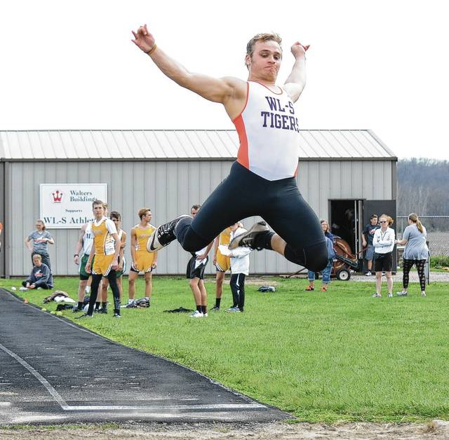 West Liberty-Salem's Brandon Wolfe (pictured) sails through the air during the boys high jump competition at West Liberty-Salem on Monday.