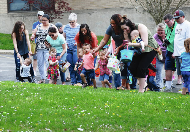 Families and children set off on the opening steps of the Easter egg hunt at Urbana High School on Saturday. The event was sponsored by the Urbana Fraternal Order of Police and Judge Gil Weithman and family.