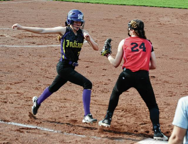 Mechanicsburg's Francys King stretches her strides to beat a throw out at first base on Friday against Cedarville.
