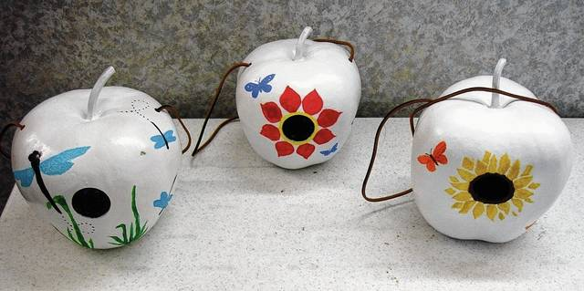 These painted gourds are on display at the Mechanicsburg Public Library.