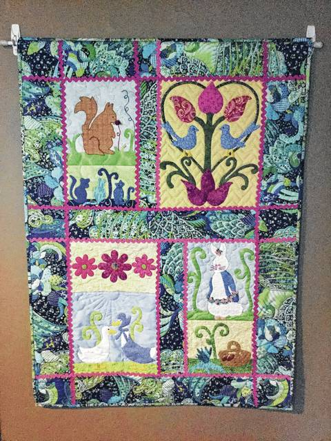 The Champaign County Quilters Guild donated quilts, including two shown here, to a quilt raffle benefiting Safe Harbor House, Springfield, a residential, faith-based facility for women who have faced hardships and who wish to improve their lives. Quilts are displayed at the Urbana Depot, Miami Street. Raffle tickets are $1 each or $5 for six tickets. Purchase tickets at the Depot Coffee House, inside Urbana Depot. Winning tickets will be drawn mid-May.