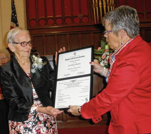 Sue Markley receives a National Society DAR award for her many hours of community service from Urbana Regent Patricia Detwiler.
