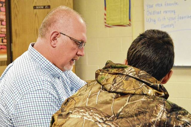 Transitions Academy principal and teacher Jerry Lenhart, left, works with a student at the alternative school.