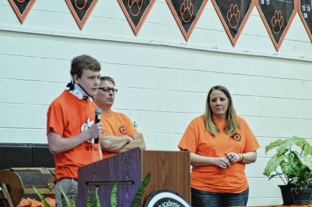 Logan Cole (left) announces his intention to donate money to the WLS Tiger Strong Field House Fund.
