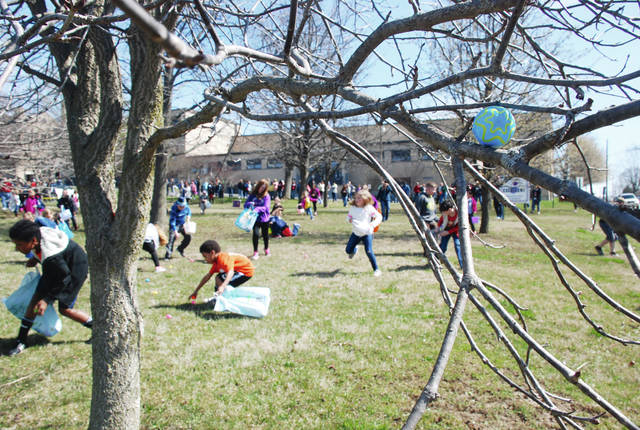 The annual community Easter egg hunt, which is sponsored by the Urbana Fraternal Order of Police Lodge 93 in partnership with Judge Gil Weithman and family, will be held at noon on April 15 in the grassy area in front of the high school. Pictured is the 2016 Easter egg hunt.