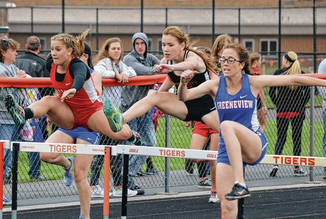 West Liberty-Salem's Addy Johnson (center) hustles for placement during the 100-meter hurdles on Thursday.