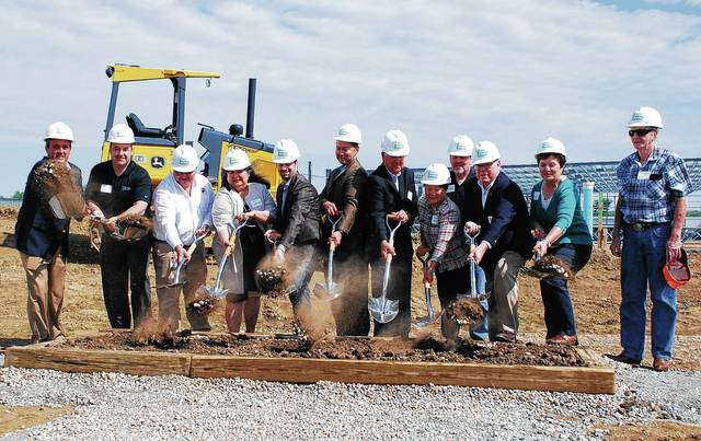 Individuals who had a hand in making the new Navistar distribution center in Urbana a reality toss dirt during a groundbreaking ceremony held Thursday at 1155 Phoenix Drive. The group includes members of the Damewood family (property owners), as well as officials from Navistar, Dublin Buildings Systems, city of Urbana and the Champaign Economic Partnership.
