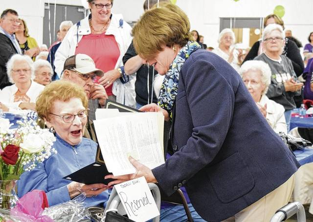 Fonda Lou Eaton, left, is the 2017 Champaign County Outstanding Senior of the Year. Area Agency on Aging Assistant Director Pat May presents the award to Eaton at the Tuesday Senior Day luncheon.