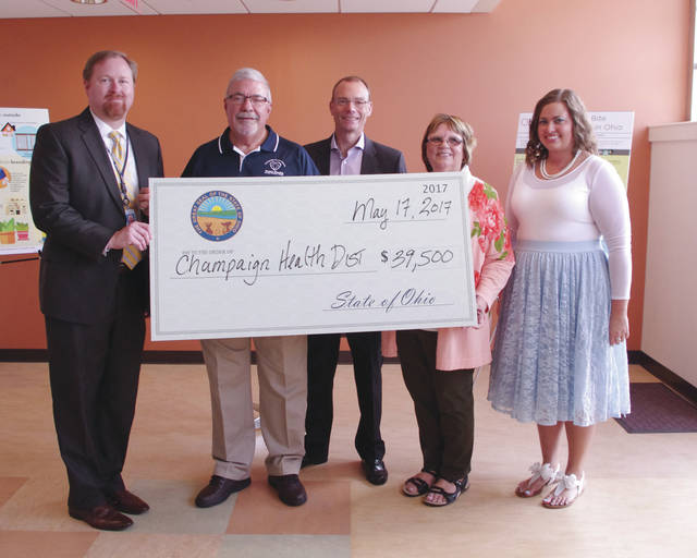The Champaign County Health District was awarded nearly $40,000 as part of a mosquito control grant program this month. Pictured from left to right Ohio Department of Health Interim Director Lance Himes, Champaign County Health District Environmental Technician Steve Moore, Ohio EPA Director Craig W. Butler, Champaign County Health District emergency preparedness coordinator Jeanne Bowman, and Leanne Greenlee of the Ohio EPA Division of Materials and Waste Management.