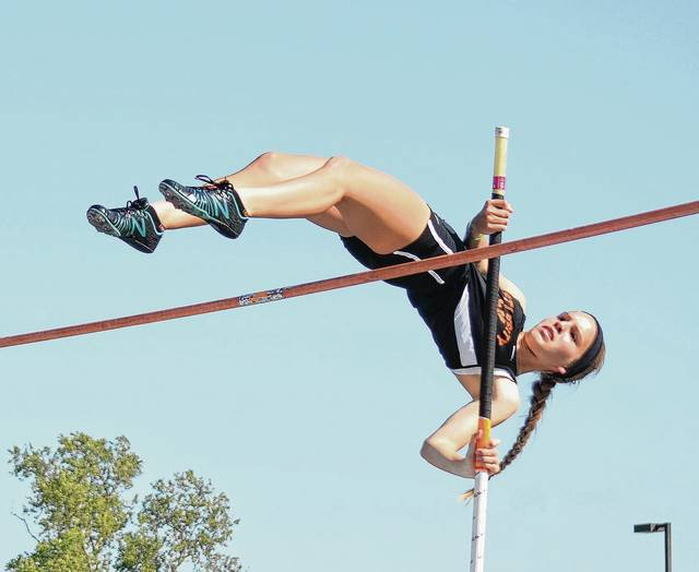 West Liberty-Salem's Lydia Moell sails over the bar during the pole vault competition on Friday at Troy Memorial Stadium. Moell finished seventh in the event.