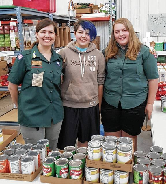 Venturing Crew 11 members, associated with Boy Scout Troop 11, with crew leader Janice Myer, are helping The WhereHouse.