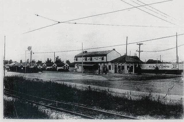 Then - This photo was taken by Jack McKeever in 1936 of Jack Tritt's Corner, located at the junction of North Main Street and Dellinger Road. The photo was taken from across North Main Street showing the interurban train line with overhead electrical wires. Tritt's Corner was a multifaceted business that included a filling station, cabins for rent and 50-50 dancing.