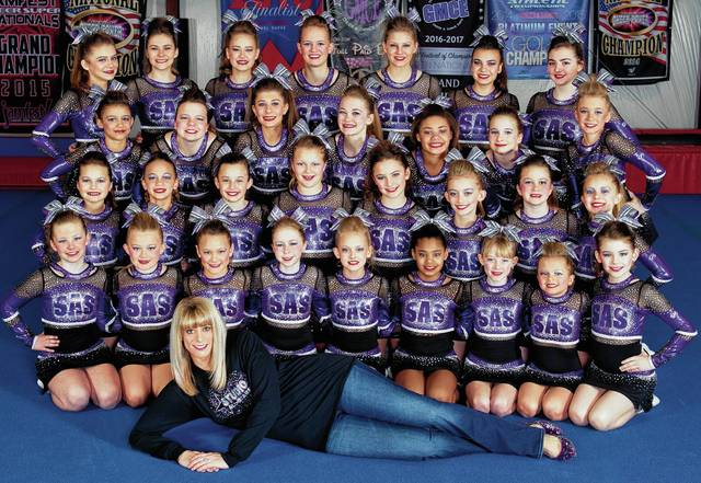 Studio All-Stars Cheerleaders pose with owner and coach Holly McGuire.