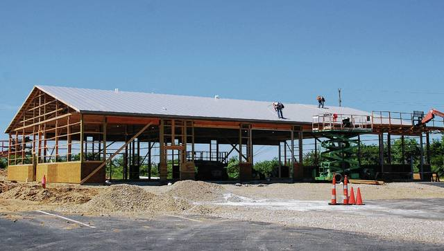 A crew puts the finishing touches on the roof of the new 6,000-square-foot Champaign Transit System (CTS) garage behind the Champaign County Community Center at 1512 S. U.S. Route 68 in Urbana. County Commissioner Steve Hess said the project, which is being handled by Howell Buildings Company, appears to be on schedule to be completed by the start of fair in August. Once finished, the 12-bay building will house CTS' fleet of vehicles, and the CTS office at 308 Miami St. will move to the county building. Once CTS has vacated its current site, the office space and garage will be transferred to the county Sheriff's Office, which is headquartered in an adjacent office.