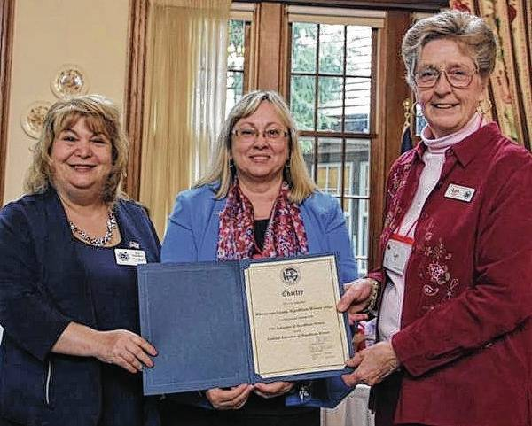 Presenting the official NFRW Charter to CCRWC President Kathy DeWeese, middle, are NFRW District Eight Director Ann Schockett, left, and OFRW President Lyn Bliss, right.