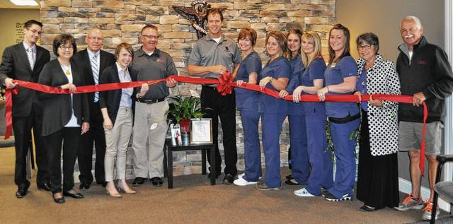 The Champaign County Chamber hosted a ribbon-cutting May 11 to celebrate the opening of the new location of Donay Life and Wellness Center at 1598 E. U.S. Route 36 in Urbana. Pictured left to right are Zachary Armstrong, Ellen Pond, Gary Lantz, Chamber Director Lydia Hess, Chamber Board President Scott DeLong, owner Dr. Jeff Donay, Wendy Young, Amy Fairchild, Lisa Rozell, Office Manager Brittany Hardwick, Amanda Hill, Marcia Ward and Greg Ward.