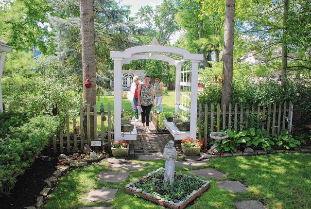 Visitors to the Sleeper garden on Court Street enjoy the view and the weather.